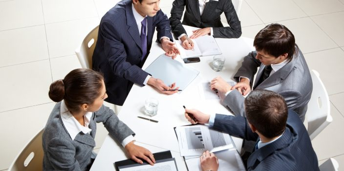 Business meetings – a thing of the past and is it normal to continue working during them?